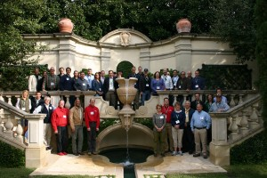 The DBI Symposium attendees pose at one of the tour's featured properties.