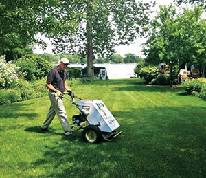 A lawn doctor tech seeds with a walk-behind turf tamer; 85 percent of lawn care operators offer seeding.