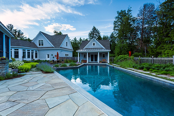 After shot: pool and house