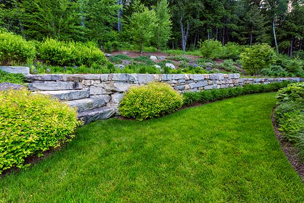 After shot of granite and stone retaining wall