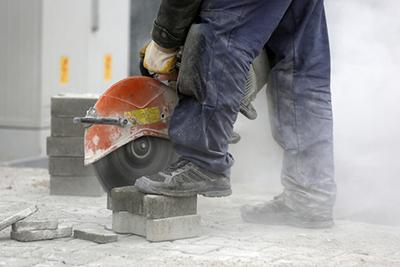 Man cutting concrete pavers